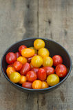Fresh juicy Heirloom tomatoes in rustic setting Royalty Free Stock Photo