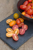 Fresh juicy Heirloom tomatoes in rustic setting Royalty Free Stock Photos