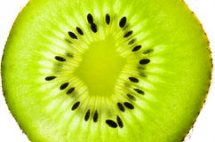 Fresh juicy kiwi fruit slice. The kiwifruit or Chinese gooseberry is the edible berry of a woody vine in the genus Actinidia. The most common cultivar group of Stock Image