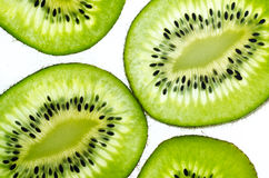 Fresh juicy kiwi fruit slice. The kiwifruit or Chinese gooseberry is the edible berry of a woody vine in the genus Actinidia. The most common cultivar group of Stock Photo