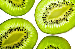 Fresh juicy kiwi fruit slice. The kiwifruit or Chinese gooseberry is the edible berry of a woody vine in the genus Actinidia. The most common cultivar group of Stock Photos