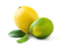 Fresh juicy lemon and lime with leaves isolated on white Royalty Free Stock Photography