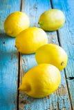 Fresh juicy lemons on a blue background Stock Photo