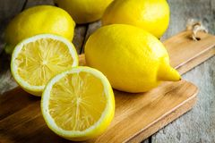 Fresh juicy lemons on a cutting board Royalty Free Stock Photography