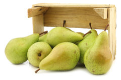 Fresh juicy migo pears in a wooden box Royalty Free Stock Images