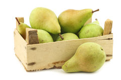 Fresh juicy migo pears in a wooden box Stock Image