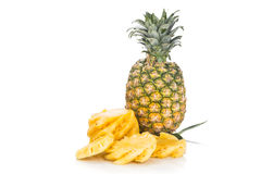 Fresh juicy nutritious cut pineapple with whole fruit as backgro Stock Photography