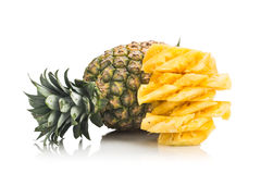 Fresh juicy nutritious cut pineapple with whole fruit as backgro Stock Images