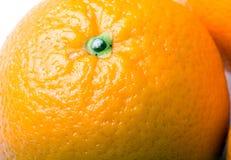 Fresh juicy orange fruit closeup. Fresh juicy ripe orange fruit closeup stock image