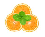 Fresh juicy orange slices and mint herb isolated on white Stock Images