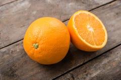 Fresh, juicy orange. On wooden background stock photo