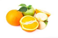 Fresh juicy oranges and apples Stock Photos