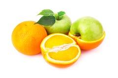 Fresh juicy oranges and apples Stock Image