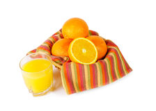 Fresh juicy oranges in  bowl and glass of orange juice isolated Royalty Free Stock Image