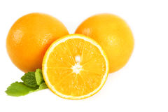 Fresh juicy oranges with leaves Stock Photo