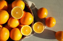 Fresh juicy oranges in wicker basket on table. Top view stock photography