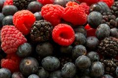 Fresh juicy organic blueberries, raspberries, blackberries, close up image