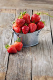 Fresh juicy organic strawberries on an old wooden textured table Royalty Free Stock Images