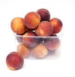 Fresh and juicy peaches in a plastic box Stock Image
