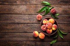 Free Fresh Juicy Peaches With Leaves On Dark Wooden Rustic Background, Above View Royalty Free Stock Photo - 92368015