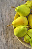 Fresh juicy pears in bowl Stock Photo