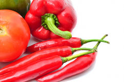 Fresh juicy peppers and tomatoes with eggplant Royalty Free Stock Photo