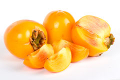 Fresh juicy persimmons with cuts on white Stock Images