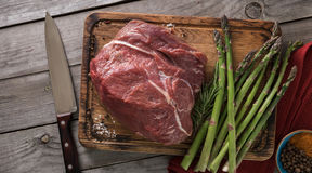 Fresh juicy piece of beef tenderloin with asparagus and spices Stock Photography