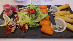 Fresh juicy pieces of sushi fish laid out on the board.Asian dish seafood sushi.Environmentally net fish food. stock video footage