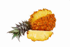 Fresh juicy pineapple with cut off slice. Isolated on white background Stock Photos