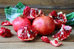 Fresh juicy pomegranates on the heap Royalty Free Stock Photography