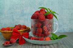 Fresh juicy raspberries in glass dish. Selective focus Royalty Free Stock Photography
