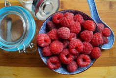 Fresh juicy raspberries in a porcelain dish. Selective focus Stock Image