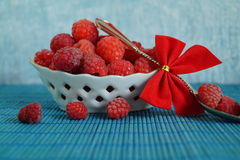 Fresh juicy raspberries in a porcelain dish. Selective focus Royalty Free Stock Image