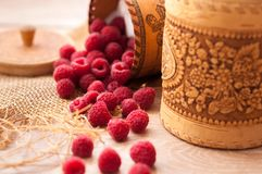 Fresh juicy raspberries. Fresh, juicy raspberries scattered on the table from bast banks Stock Images