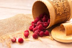 Fresh juicy raspberries. Fresh, juicy raspberries scattered on the table from bast banks Stock Image