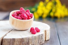 Fresh juicy raspberries in a wooden bowl. The concept is healthy. Food, diet, vegetarianism, vitamins Royalty Free Stock Photos