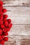 Fresh juicy raspberry on wooden background Stock Photo