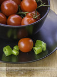 Fresh juicy red cherry tomatoes and green hot pepepr Stock Photos