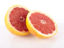 Fresh juicy red grapefruit. On white - reflection Stock Photo