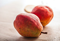 Fresh juicy red pears on wooden table Stock Photo