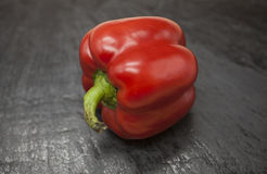 Fresh juicy red sweet pepper close up on a stone background Stock Photos