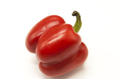 Fresh juicy red sweet pepper close up on a white background. Stock Photos