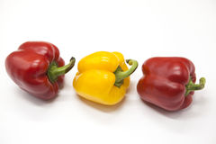 Fresh juicy red  and yellow  sweet pepper close up on a white background. Stock Photo