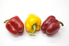 Fresh juicy red  and yellow  sweet pepper close up on a white background. Royalty Free Stock Images
