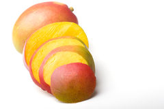 Fresh juicy ripe mango tropical fruit sliced. Isolated stock photo