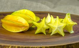 Fresh, juicy and ripe star fruits on a wooden background.  stock photo