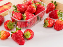 Fresh juicy strawberries. On a wood tray stock photography