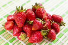 Fresh juicy strawberries lying on the table. Royalty Free Stock Image