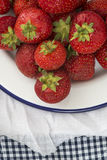 Fresh juicy strawberries on vintage enamelware crockery on rusti. Fresh juicy strawberries on vintage enamelware on rustic background Stock Photo